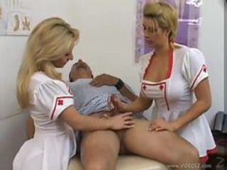 Hot and busty nurses give a handjob