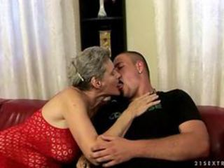 Busty granny fucking with a boy
