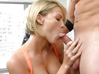Kayla Synz is a hot older lady with a short haircut and a deep throat