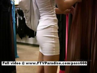 Superb Amateur cute teen babe choosing clothes and showing pussy in public store