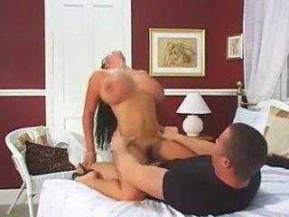 Heavy breasted hottie gets on top to bounce