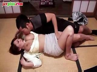 Busty Asian babe sucks his co...