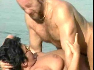 Mature fucking on a beach