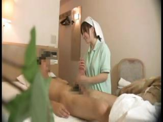 Hidden Cam Films Japanese Nurse Doing Some Extra Care On His Cock
