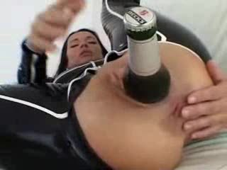 Bottle Of Beer Inside The Latex Girl's Ass