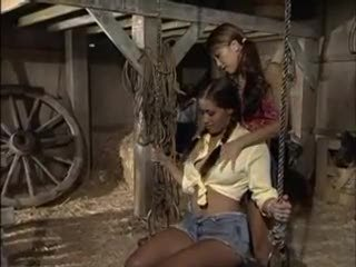 Pretty girls in the barn sharing dildo