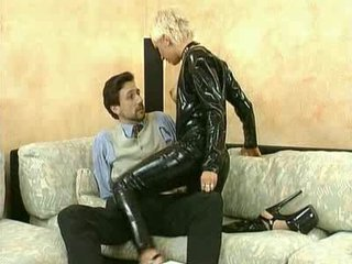 Chick in latex gives head and rides him