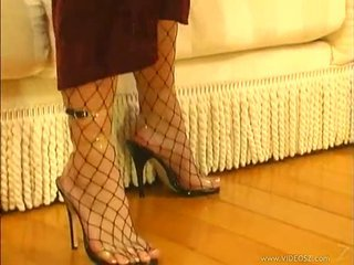Fishnet pantyhose are amazing on this slut