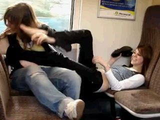 sister and friend play facefootsie in train
