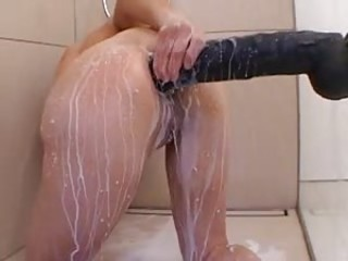 Milk and a significant toy up their way ass on touching shower