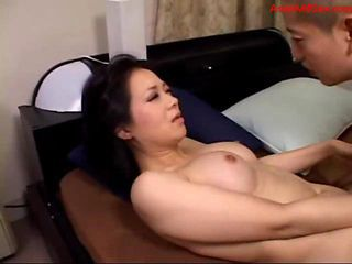 Busty Milf Sucking Young Guy Riding On Him On The Bed