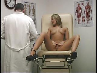 Sexy Bodied Chick Joey Valentine Takes Off Her Bra And Thong Panties Before She Spreads Her Perfect Long Legs In Front Of Doctor. He Examines Her Nicely Shaved Pussy And Feels Horny.