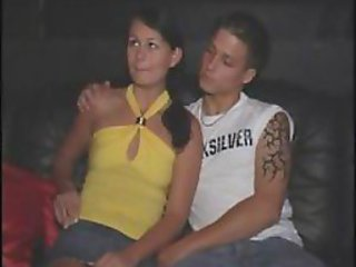 Young couple having fun in a sex club