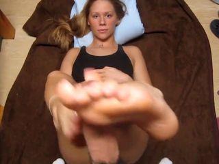 Young girl doing footjob