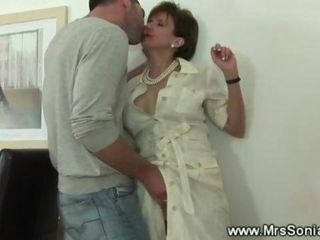 Rich older lady wearing high heels makes boy lick her pussy