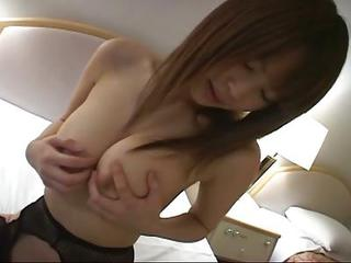 Cute Japanese Doll Plays With Hu...