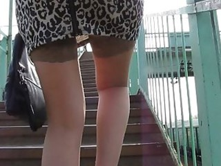 Girl in tan stockings going upstair