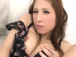 Sultry Tsubasa Aihara in black and pink lace lingerie fingers her trimmed...