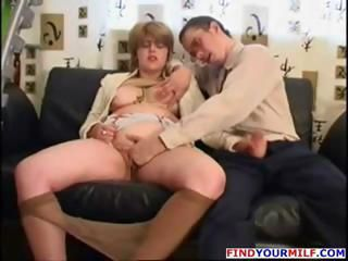 Busty blonde mature gets felt up and she gives him a handjob