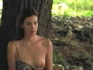 Liv Tyler takes her top off to be painted by the tree