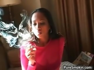 Sexy ebony hoe lights a cigar part3