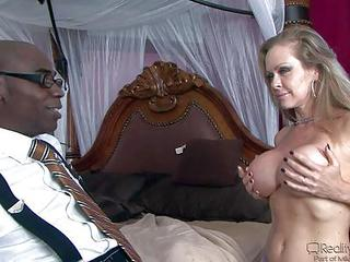 Dyanna Lauren Is A Good Looking Mature Woman With Massive Fake Tits And Nice Ass. She Takes Off Her Bra In Front Of Sean Michaels To Turn Him On Before Taking His Black Dick. He Loves Her Gorgeous Body!