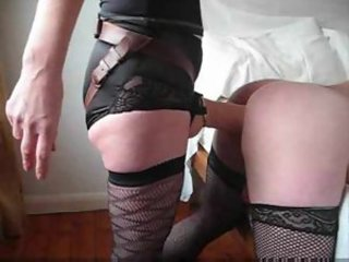 Sissy in stockings takes big strapon