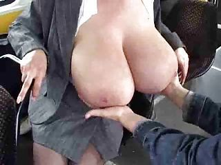 Mature milks her big tits on the bus.