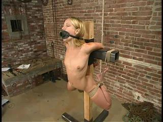 Blonde bound with rope and whipped