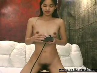 Gorgeous skinny natural Asian Teen beauty Reika, 19 years, with a hairy untrimmed teen pussy, riding the sybian and getting a pure deep orgasm