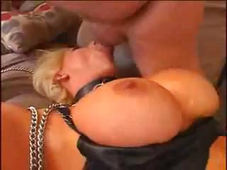 Nasty blonde, with huge tits and fishnets, gets her ass fucked hard and likes it