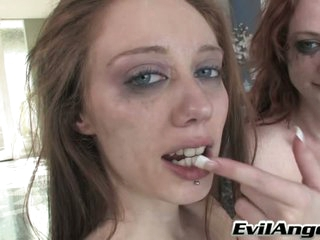 Ruby Red and lusty chick do cum swapping