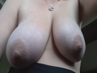 My wife's big natural breasts, groped and fondled