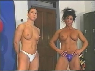 Topless wrestling - fitness model vs. female bodybuilder par free