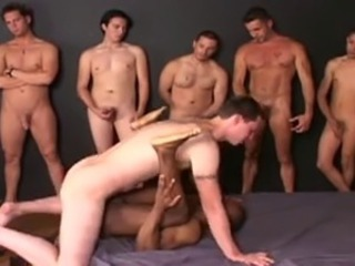 Black dude fucked bareback by nine men in a hot bukkake.