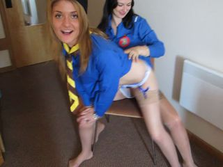 2 girls stripping each other from their guide uniforms