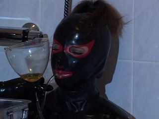 Latex Mistress Pours Some Yuck In Her Slave Throat