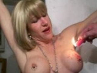 Milf's pierced cunt is tortured by hot wax & dildo