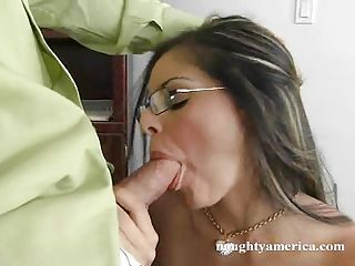 Kinky brunette Mikayla gets a mouthfull of shaved cock inside an office