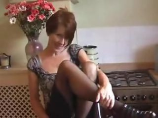Mature in her kitchen does sensual striptease