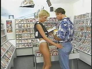 German Blonde Does Costumer In Videostore!