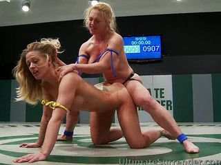 Big breasted babes wrestle...