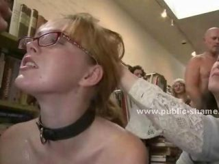 Horny schoolgirl gets stripped and force to give free handjobs in a book store while being kissed and rubbed by curious women that watch her also get brutally fucked