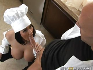 Sexy busty chef Carmella Bing kneels her way on a meaty cock in the kitchen