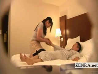 A relatively pert Japanese milf masseuse with sumptuous meaty arms tries to keep a straight face while massaging her supine yukata clad businessman client who sallies out his hard member and begins masturbating while keeping up the sexually fuel