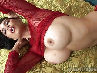 Steaming hot Tera Patrick getting naughty on the bed with herself