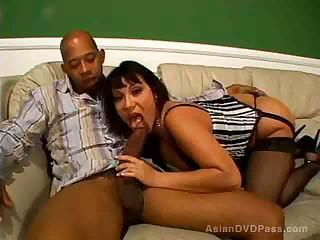 Asian milf sucks a hug black stick