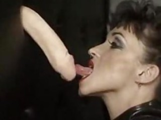 Huge tit chick in latex gives gloryhole blowjob