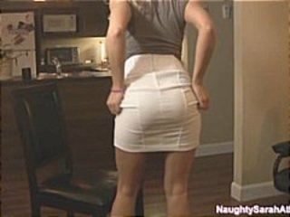 Blonde housewife has a fine ass and shows it off in the kitchen