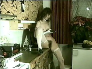 Horny Maid Debbie Van Gils Crams a Cucumber Up Her Hairy Pussy